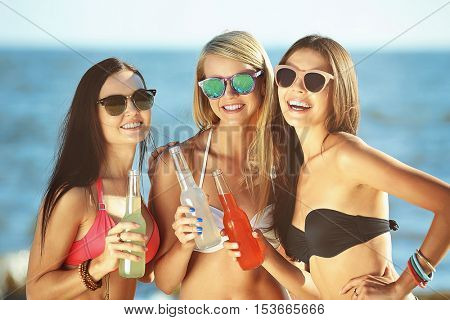 Happy girls having fun on beach