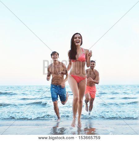 Happy friends having fun on beach