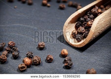 Black Pepper On Rustic Stone Background. Overhead View Food Photography.