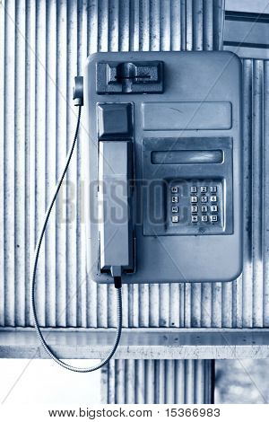 Public telephone. Blue tint, front view.