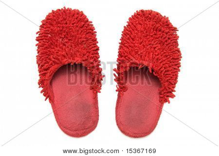 Red slippers. Isolated on white.