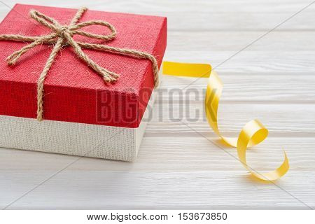 Gift Box On A White Wooden Background.