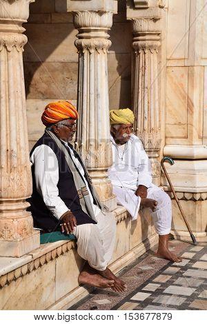 BIKANER, RAJASTHAN, INDIA - FEBRUARY 14, 2016 - Unidentified indian men sitting and resting outside Karni Mata rat temple in Deshnoke (Bikaner)
