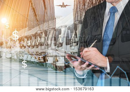 Double exposure of businessman is booking trade with blurred cargo and transportation truck. Transportation logistic business trade concept.