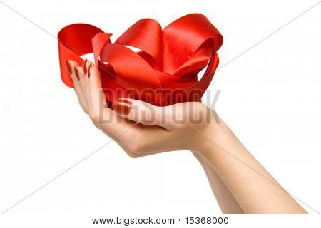 Woman hand holding red ribbon. Isolated on white.