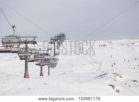 Ski lifts in ski resort up high in mountains