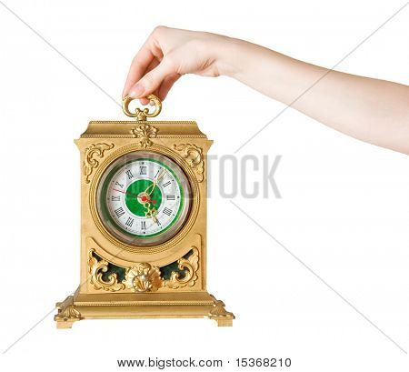 Woman hand with ancient clock. Isolated on white.