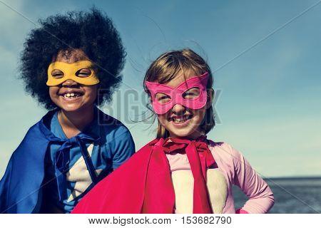 Kids Enjoying Playing Costumes Dreams Imagination Concept