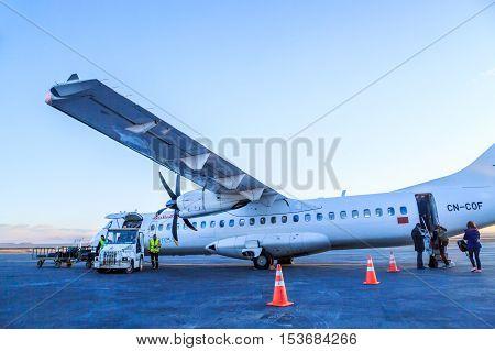Ouarzazate, Morocco - Feb 28, 2016: Agents Of The Airline Charges Passengers' Luggages In The Hold O