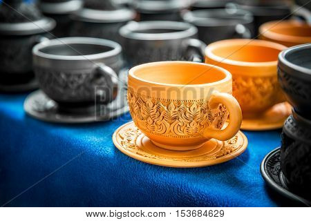 Ancient thai art engrave pattern on the traditional pottery coffee cup