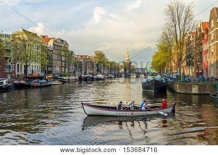Amsterdam the Netherlands - April 13 2016: beautiful Amsterdam canal scene