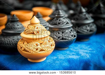 Thai art engrave pattern on the traditional pottery