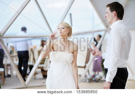 Beautiful young bride and groom outdoors on summer day