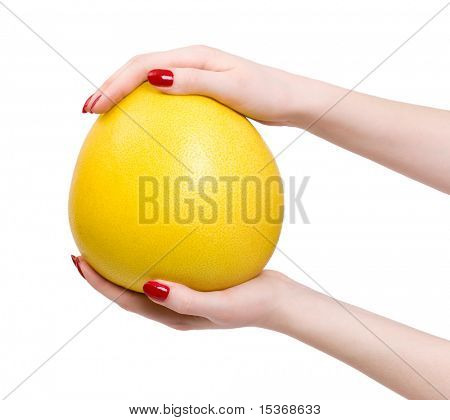 Woman hands with tropical citrus fruit. Isolated on white.