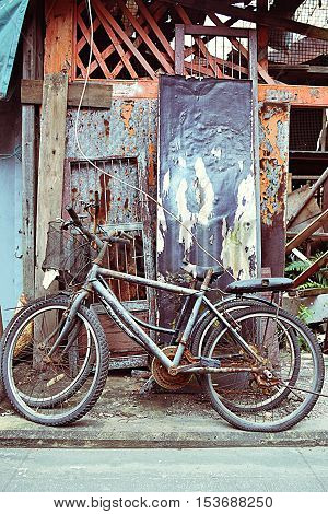 Old abandoned bicycles outside an old house in Tai O fishing village, Lantau island, Hong Kong S.A.R