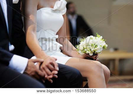 Bride Holding Flowers At The Wedding Ceremony