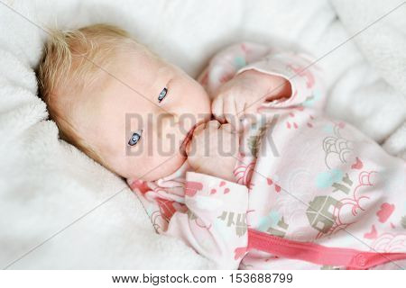 Adorable newborn baby girl portrait at home