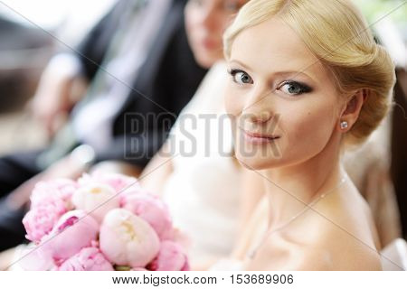 Beautiful young bride portrait outdoors on summer