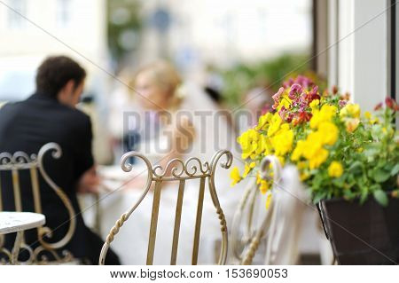Nice Flowers With Bride And Groom On The Background