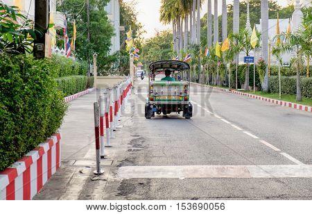 Bangkok Thailand - December 9 2015: Tuk Tuk is parking in front of Golden Mount Temple. Thai traditional taxi in Bangkok Thailand.