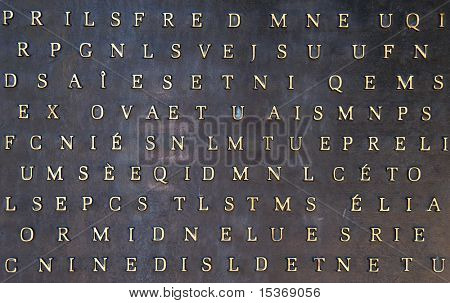 Absctact background with metallic letters on stone surface.