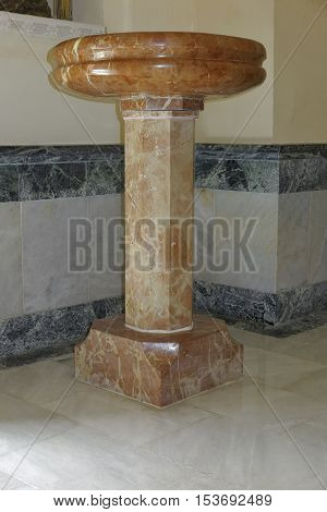 marble pedestal placed in a corner of the room