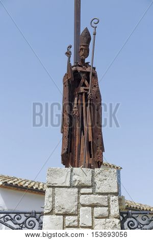 statue of St. Gregory in the town hall square of El castell de guadalest in the province of alicante spain