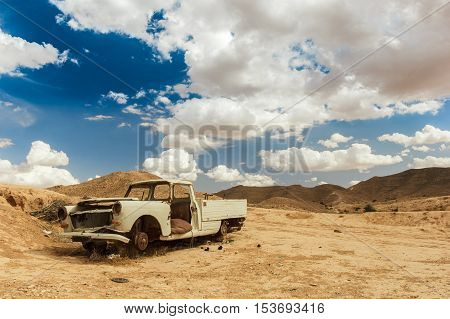 Desert Relic. Old Car rusting away in the desert. Africa.