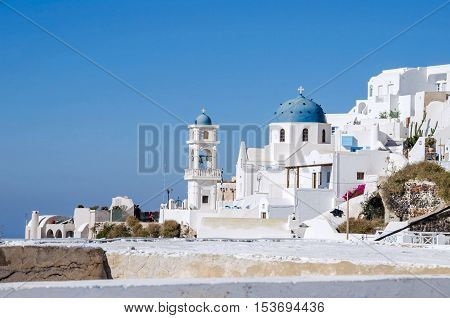 View of Imerovigli example of Cycladic architecture with its low-lying cubical houses made of local stone and whitewashed with various volcanic ashes used as colours. Santorini island. Greece.