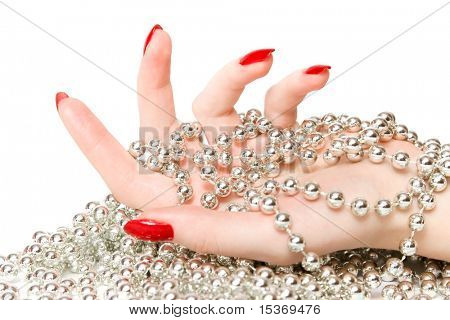 Woman hand with silver glassbeads. Isolated on white.
