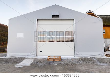 Facade of storage warehouse with closed gate
