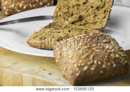 Close up of freshly baked rolls for breakfast on a wooden board