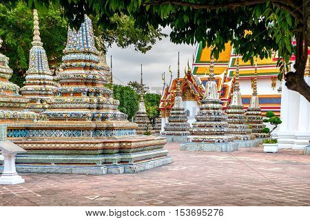 Classical Thai architecture in Wat Pho Bangkok Thailand. Wat Pho is a Buddhist temple complex with Reclining Buddha.