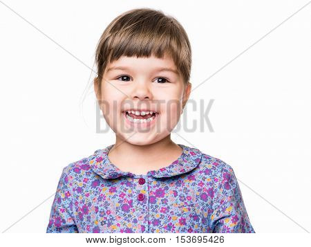 Emotional portrait of a 3 years old girl, laughing. Cute caucasian baby isolated on white background. Beautiful preschool child posing in studio. Healthy carefree kid playing indoors.