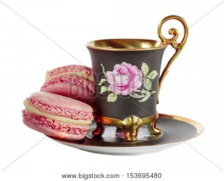 Cup of coffee with French macarons isolated on white background