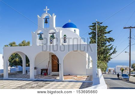 One of many typical chapels of Greek Orthodox Church on the greek island Santorini in Thira with its typical blue painted dome and three bells