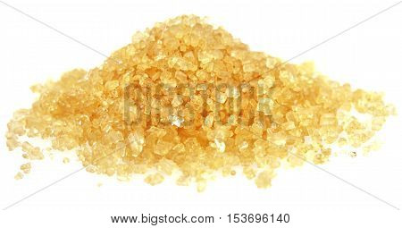 Heap of golden Cane Sugar.  Isolated from white background. Soft focus view.