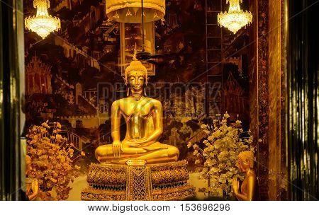 Bangkok, Thailand - December 6, 2015: Golden Buddha statues in a Thai Buddhist temple Wat Phra Borommathat Maha Chedi Bangkok Thailand.
