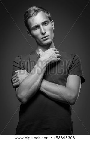 Handsome Man In Black T-shirt Posing On Background. Model Tests