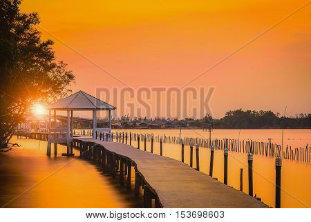 White Pavilion near the seaside at sunset in Thailand.