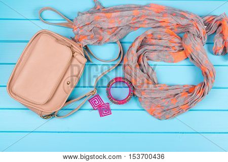 Set of the fashionable women's acsessories. Blue wooden background.