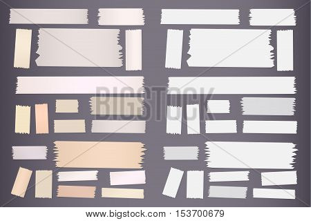 Pieces of different size sticky, adhesive masking tape are on grey background.