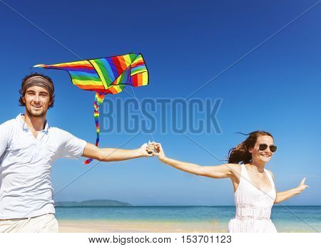 Beach Kite Couple Cheerful Vacation Tropical Concept