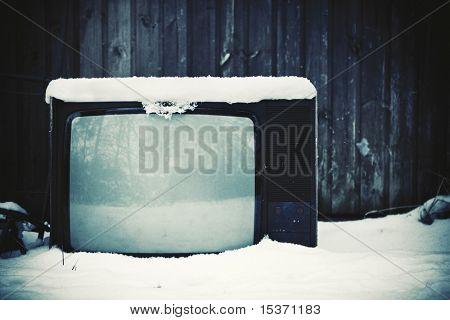 Old useless TV concept. Winter season.