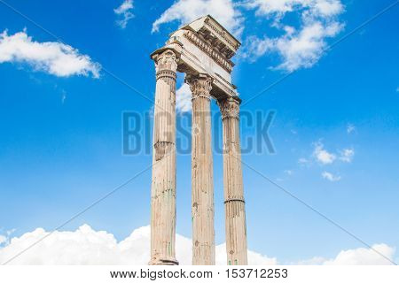 Ruins and columns of temple of Castor and Pollux in Roman Forum (Forum Romanum), , blue sky in background, Rome, Italy