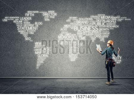 Female construction worker in room and globalization concept