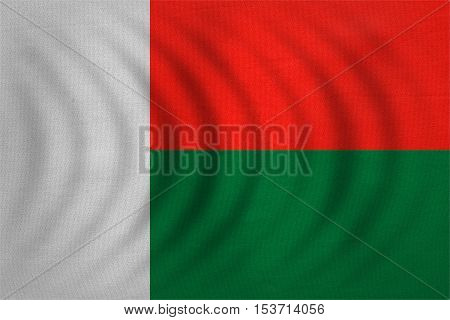 Madagascar national official flag. African patriotic symbol banner element background. Correct colors. Flag of Madagascar wavy with real detailed fabric texture accurate size illustration