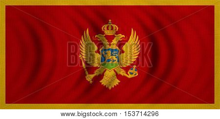 Montenegrin national official flag. Patriotic symbol banner element background. Correct colors. Flag of Montenegro wavy with real detailed fabric texture accurate size illustration