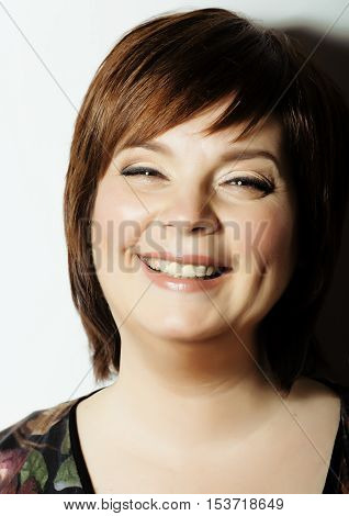 mature fat cheerful smiling woman close up isolated in studio on white background