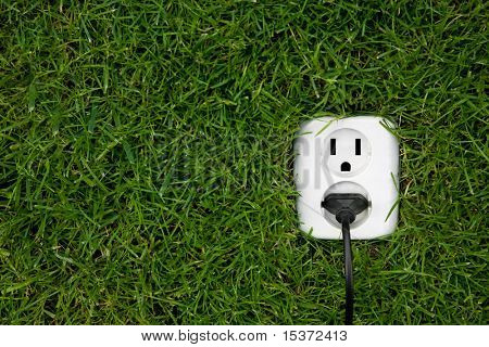 energy concept outlet in grass